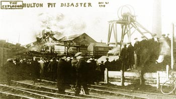 December 21, 1910 - Onlookers wait anxiously as smoke bellows from the Hulton Colliery from the No. 3  Shaft - Bolton Evening News